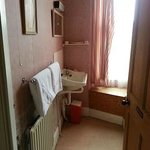 The grubby and dated bathroom