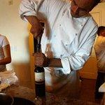 Chef Pablo Velez opens a bottle of vino