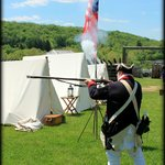 reenactment of soldier shooting a musket