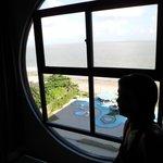 Vista do mar da janela do Apto
