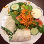Veggie wrap and side salad with blue cheese dressing
