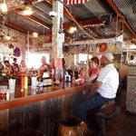 Bar with saddle bar stools