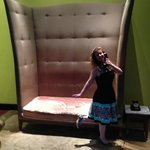 My beautiful wife in front of the big chair in the lobby. Some kind of Alice in Wonderland decor