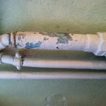 pipe near headboard