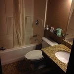 Rm#117 Double Queen Beds with new bathroom granite sinks and stone tile floors.