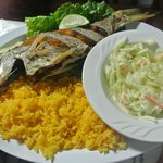 Fried fish with yellow rice and coleslaw