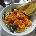 Seafood pasta with cheese and garlic bread