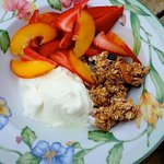 Yogurt, granola and mixed fruits