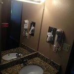 Rm#225 Double Queen Kitchenette, new granite sink and stone tile bathroom floor.