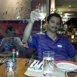 Sudarshan Iyengar with a glass of champagne