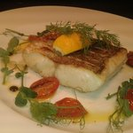 Hake with slow roasted baby plum tomatoes and peashoots