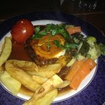 Vegetarian Nut Roast topped with Goats Cheese.