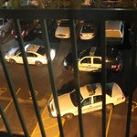 Police cars out back in the middle of the night, after arresting a hotel patron