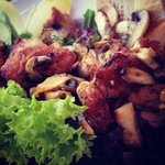 Grilled chicken salad with mushrooms and onions.