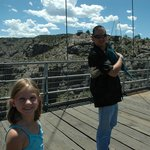 Crossing the old wooden bridge (with our bird, the park is pet friendly)