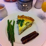 Delicious goat cheese and mushroom quiche with asparagus and sausage