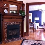 Beautiful fireplace in front parlor with dining area in view