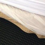 plastic sheet hanging over bedskirt