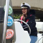 The hen, expertly steering the boat!