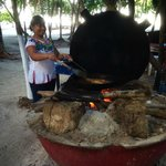 Cooking over the open fire at Chamicos in Soliman Bay, Riviera Maya Mexico
