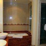 Great bathroom - bath tub with shower, separate shower cubicle, toilet, bidet & two washbasins.