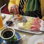Breakfast, big orange juice, tasty meats and cheese, and wonderful eggs.