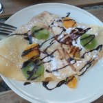 Pancake with fruits and coconut