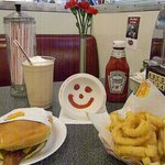 Double bacon cheese buger and  rings and fries, milk shake