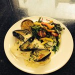 Turbot in a mussel cream sauce with salad.. ��