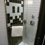 Shower room with Space Invaders tiles