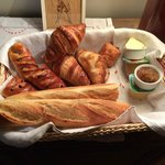 an awesome basket of bread and croissants