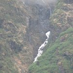 Waterfall runs down the mountainside.