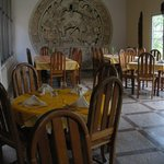 The Dining Room at Tikal Inn  with a Maya Muriel on the wall