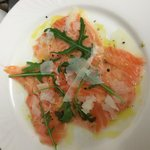 Carpaccio of Salmon, wild rocket and Shavings of Parmesan
