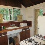 kitchen has dishes/flatware/pans