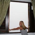"No ""glass"" window, just shutters. AC keeps the room plenty comfy."