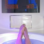 Relaxing in the deep,hot bath watching TV... Bliss