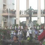 Famous Oblation at  Quezon Hall with crowd celebrating the University's Centennial 2008