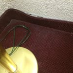 Floor in room seemed as though it hadn't been vacuumed in quite some time. That is an earring to