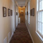 old photos and crystal chandeliers in all corridors
