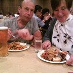 gran and grandad enjoying good food with family
