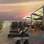 Watch the sunset from the roof top terrace!