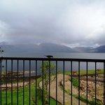 A sparrow on the balcony and a rainbow beyond