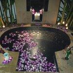 Sunken spa bath with flower petals