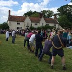 Tug o War on the village green at the gates to the park. Earle Arms in the background