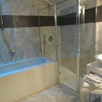 Separate shower and bathtub with mood lighting!