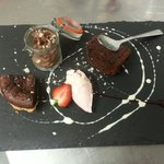 Chocolate plate consisting of Brownie, torte and mousse.