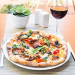 Enjoy brick oven pizza and a glass of wine!