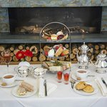 Afternoon tea by the fire in the Orangery