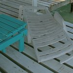 two broken Lounge Chairs at the end of the pier